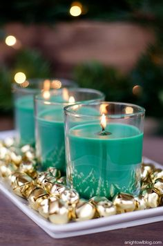 Forget silver and gold — teal and gold makes for an equally stunning (and surprisingly festive) Christmas scene. This project couldn't be easier — simply purchase a bag of jingle bells and three candles in the same hue. Put it all together on a rectangular serving dish and light candles 15 minutes before guests arrive for a sweet-smelling Christmas night. Get the tutorial at A Night Owl Blog »