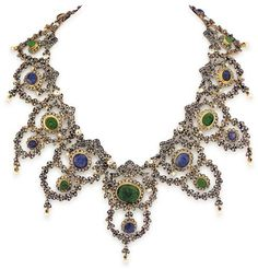 """Gerardo Sacco, Silver on Gold, Diamond, Carved Emerald, Sapphire and Natural Pearl Lady's Necklace, Provenance Elizabeth Taylor. Signed """"Sacco"""" on clasp. Floral swag and garland design set with round rose cut diamonds, approx. 104 round, faceted blue sapphires and seed pearls throughout.  Also set with ten natural  blue sapphire and nine natural  emerald carved cabochons (tutti-fruiti style). Worn by Elizabeth Taylor in Franco Zeffirelli's film """"The Young Toscanini""""."""