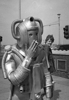 Funny Pictures: vintage snap of man dressed as alien robot smoking cigarette