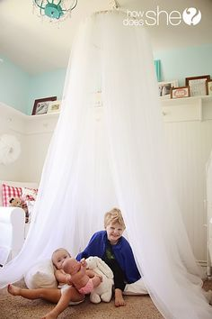 Ultimate fun and uber-simple construction.  I wonder if I could find a metal ring, though . . . my kids might snap an embroidery hoop.  A Dreamy Canopy Tent | How Does She...