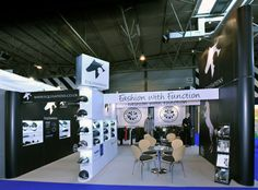 This stand proves that you don't need bright colours to draw attention. The black and white theme from the silhouette-style logo has been continued throughout the whole stand, creating stark contrasts that give an elegant but bold look. Endcap showcases have been used to great effect to display riding hats, maximising the use of space and ideal for drawing in attention from passers by.