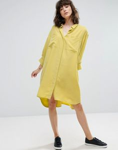 Smooth woven fabric Spread collar Concealed button placket Chest pockets Dipped hem Oversized fit - falls generously over the body
