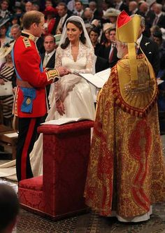 Prince William, grandson of Queen Elizabeth II and son of Charles, Prince of Wales, puts the ring on the finger of his bride, Catherine Middleton, during their wedding ceremony. More images of this event: Catherine and William Royal Wedding Pictures
