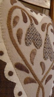 Cottonwood Lane Primitives: close-up of applique' flowers, dots, shades of brown, taupe, cream quilt