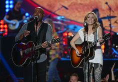 """Crank up the """"Wagon Wheel."""" Darius Rucker and Sheryl Crow perform Rucker's hit during a performance on the 2013 American Country Awards on Dec. 10 in Las Vegas"""