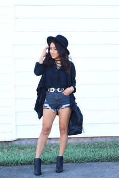 Rocker chic style via www.jessicafashionnotes.com  Wearing double buckle belt, edgy booties, lace up top, blouse, all black, style, fashion