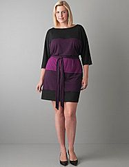 Figure-flattering dolman dress takes on the colorblock trend with the season's best hues. Sexy dolman silhouette is a fashionable choice for work or weekend, and is detailed with a boat neck, elbow sleeves and tie belt. Soft, feel-good knit makes dressing up effortless. lanebryant.com