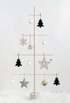 DIY Wood Dowel Tree - Homey Oh My Modern Christmas tree alternative for small spaces.<br> Modern Christmas tree alternative for small spaces. Christmas Tree Design, Wooden Christmas Trees, Noel Christmas, Rustic Christmas, Christmas Crafts, Christmas Ornaments, Christmas Tree Ideas For Small Spaces, Unusual Christmas Trees, Christmas Ideas