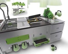 Designer FALTAZI - kitchen concept system: Ekokook does it all, from use and re-use of your solid waste, liquid waste, organic waste, oh…and cook too. It has a combo fridge/freezer, steam oven, and two-tier dishwasher. Non-smelly waste is placed into a bin and compacted into briquettes. The double sink collects water that is filtered to be reused on the plants hanging above it. Organic waste is taken care of by earthworms and then further recycled into food for indoor and outdoor plants.