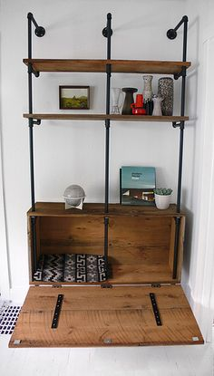 interior of pipe shelf storage unit. I really like the added closed off storage at the bottom