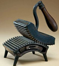 Dion Rocker Fluter - a type of iron, with a slug heated on the stove, that pressed in pleats or gathers for ruffles.