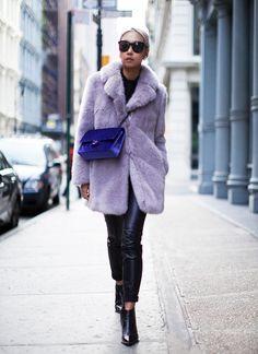 Vanessa Hong of The Haute Pursuit gets colorful in a violet fur coat + purple velvet cross-body purse