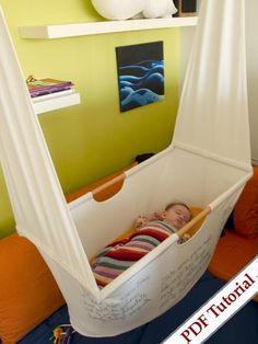this a cool hanging cradle!  And so easy to store for the next baby!  Sweet!