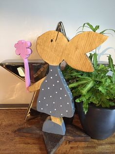 A personal favourite from my Etsy shop https://www.etsy.com/uk/listing/593875179/large-wooden-freestanding-rabbit-holding