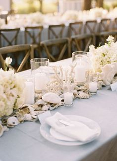 Beach wedding centerpiece ideas pinned by afloral from http beach inspired decor love all the shells and other beach details down the center of junglespirit Images