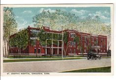 Vintage 1920s color postcard showing St. Joseph's Hospital at Concordia, Kansas. Published by Commercial Chrome card no. 51464. Card measures 5.5 x 3.5 inches and is unused. Condition is excellent.