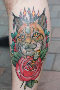 Nicely stylized cat (Lynx?) ~ Tattoo by Roger Axelsson & Håkan Havermark