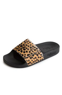 Loeffler Randall's Cat Slide ($225) in cheetah printed haircalf is the ultimate sandal for casual days. #catslide #dianiboutique #slipon #sandal #slide #cheetah