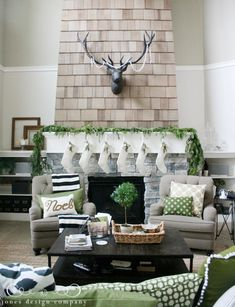 Muted green accents adds a festive yet subtle touch to this Christmas mantel. #decor #holidays #christmas