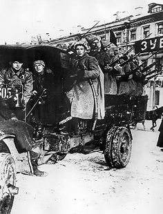 Petrograd, Russia: Bolshevik fighters pose atop a truck captured during the Great October Socialist Revolution, November 7, 1917.
