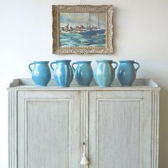 Every shade of blue 🔷 (Raise your hand if you remember that Bananarama song 🎤🎼 #LoveThe80s !) A vignette of French seascape of Brittany, Swedish sideboard and European pottery at our shop #toneontoneantiques #swedishantiques #gustavian