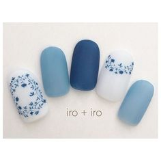 matte white blue and light blue nail art with simple elegant delicate flowers