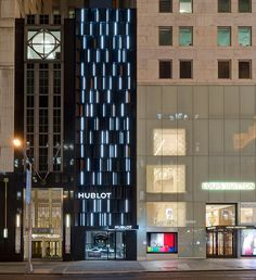 externally, a faceted elevation is clad with powder coated black aluminum panels that rise 70 feet (21 meters) above the street.