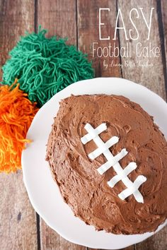 This Easy Football Cake is the perfect addition to your game day menu! Moist Chocolate Cake topped with the Best Chocolate Buttercream EVER makes for the perfect plate of sugar to root on your favorite team with!