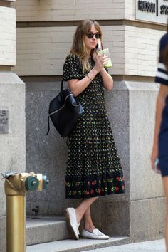 """I've been not-so-casually obsessed with Dakota Johnson for awhile now – and I haven't quite been able to figure out why. She's not your typical Insta-girl. She doesn't overshare. She doesn't wear extremely glamorous clothing, or pose for photos in a way that suggests she's """"just always this beautiful"""". She may be friends with Taylor Swift, but is not an explicitly public member of that clique. She just seems to be…herself."""