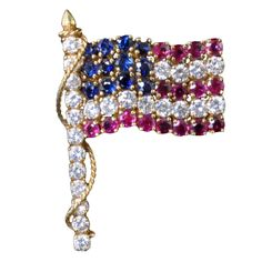 VAN CLEEF & ARPELS Elizabeth Taylor's USA Flag Brooch | From a unique collection of vintage brooches at http://www.1stdibs.com/jewelry/brooches/brooches/