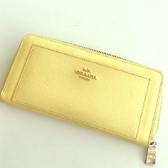 Coach wallet ❌❌SOLD❌❌Gorgeous yellow wallet. Excellent condition! Smoke free home; ships immediately; smoke free home! Coach Bags Wallets