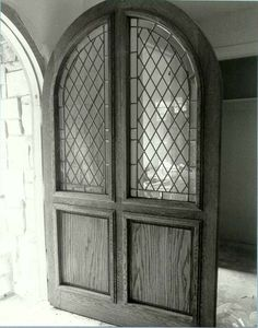 diamond leaded glass pane arched doors