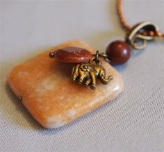 Lucky Elephant calcite pendant with goldstone the combined effect of these stones is a sense of well being, optimism, energy, and enhanced will power.