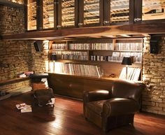 New York City loft. There are few things better than a comfy chair, good music, a glass of wine, and a great book.