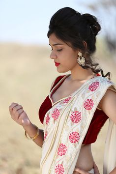 Featured here is the exquisite Camellia design, a cream silk georgette saree… Indian Beauty Saree, Indian Sarees, Bengali Saree, Pure Georgette Sarees, Red Saree, Saree Blouse, Elegant Saree, Beautiful Saree, Beautiful Beautiful