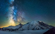 Mt Rainier with clouds below and the Milky Way by kdsphotography [OC] [1200x750]