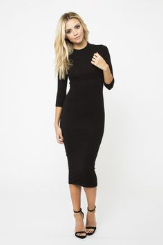 A funnel neck and sleek silhouette make this body conscious dress a definite knockout. Fully lined, pull on styling makes it incredibly easy to wear. 95% viscose, 5% spandex.