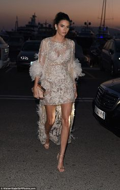 Legs eleven: The 20-year-old supermodel wowed in a dazzling two-piece boasting a champagne...