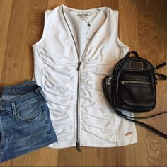 """New Spanner white cotton blend vest New Spanner sport best white with zipper size small. 95% cotton and 5% spandex. Two way silver zipper and hardware logo. 23"""" length and 17"""" chest Spanner  Tops"""