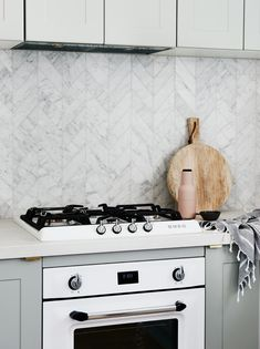 The norsuHOME - Kitchen Photographer: Lisa Cohen Stylist: Beck Simon  Tiles: Perini Tiles Cabinetry: kaboodle Kitchens Benchtop: Caesarstone Appliances: Smeg