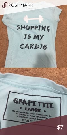 Shopping is My Cardio Worded Tee Ladies fit -- size L but fits snug -- cap sleeves -- mint green/blue -- very good condition -- worn once. Pet free and smoke free thank you graffitee Tops Tees - Short Sleeve
