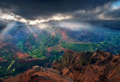 Waimea Canyon on the island of Kauai is a spectacular site at any time of day, but this sunrise proved to be the most dramatic. Storm Veil by Harry Lichtman.