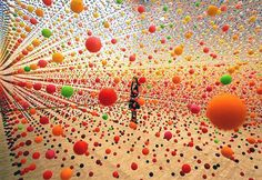 This installation by artist Nike Savvas is made of thousands of suspended balls creating a dense field of colour gently moving in the breeze created by a nearby fan. (Saatchi Gallery)