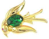 #Vintage Signed Coro Pegasus gold plated swallow in flight brooch. Listed in several vintage costume #jewelry books. Gold-tone bird has a large oval, faceted emerald green, p... #wedding #vintage #ecochic #teamlove #ezvintagefinds