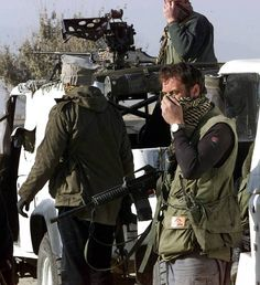 British special forces cover their faces as they arrive at a battlefield in northern Afghanistan, 2001