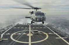 ATLANTIC OCEAN (JAN. 15, 2014) A Sikorsky SH-60R Sea Hawk helicopter assigned to the Grandmasters of Helicopter Maritime Squadron (HSM) 46 lands aboard the guided-missile frigate USS Halyburton (FFG 40). A detachment from HSM-46 is deploying with Halyburton to the U.S. 4th Fleet area of responsibility. (U.S. Navy photo by Mass Communication Specialist Kameren Guy Hodnett/Released)