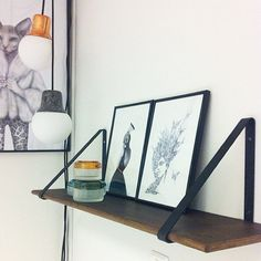 ferm LIVING Shelf and Shelf Hangers:  http://www.fermliving.com/webshop/shop/all-products/shelf-smoked-oak.aspx  http://www.fermliving.com/webshop/shop/all-products/metal-shelf-hangers.aspx