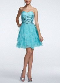 A modern take on a traditional shape, this short prom dress hits all the trends for a look that will get you noticed!   Strapless bodice features intricate and sparkling sequin detail.  Short ruffled tulle skirt gives this dress a fun and flirty feel.  Fully lined. Back zip. Imported polyester. Sport clean.