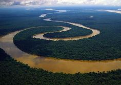 The Amazon River in South America happens to be the WIDEST river in the world. It is by far the largest when it comes to volume of water discharged. The width of this natural giant can go up 25 miles in rainy seasons. All of this makes the South American river the largest drainage system in the world, according to Encyclopedia Britannica. Its recorded source is in the Andes Mountains and it flows down to its Atlantic Ocean mouth off the coast of Brazil.