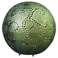 Spherical iron table lamp with scrolling cut-out detail.  Product: LampConstruction Material: IronCo...